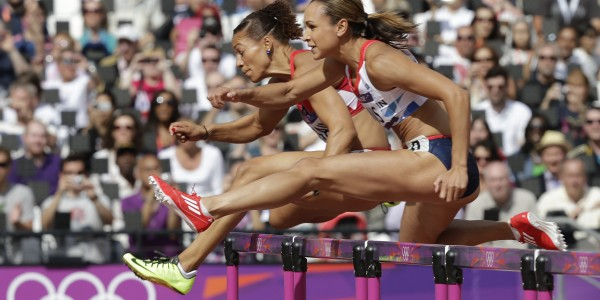 Britain's Jessica Ennis clears a hurdle in the 100-meter hurdles of the Women's Heptathlon during the athletics in the Olympic Stadium at the 2012 Summer Olympics, London, Friday, Aug. 3, 2012. (AP Photo/David J. Phillip)